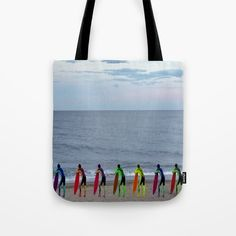 """Beach tote for the summer? Check out the full range of products with these Neon Surfers Waiting in Line! Our quality crafted Tote Bags are hand sewn in America using durable, yet lightweight, poly poplin fabric. All seams and stress points are double stitched for durability. Available in 13"""" x 13"""", 16"""" x 16"""" and 18"""" x 18"""" variations, the tote bags are washable, feature original artwork on both sides and a sturdy 1"""" wide cotton webbing strap for comfortably carrying over your shoulder."""