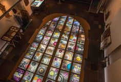 'Marc Mulders. 'ERASMUS' stained glass window, now at the floor, museum Gouda, in Spring 2016 installed at the St. John's Church Gouda.'