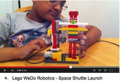 A young engineer demonstrates his rocket launchpad built and programmed with LegoWeDo.