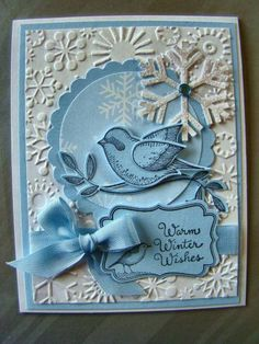 snowflake embossing folder, snow flake stamping and punched snowflake . two step bird punched in blue . layered circle and sentiment label . Christmas Cards To Make, Xmas Cards, Holiday Cards, Snowflake Background, White Snowflake, Bird Cards, Butterfly Cards, Bluebirds, Marianne Design