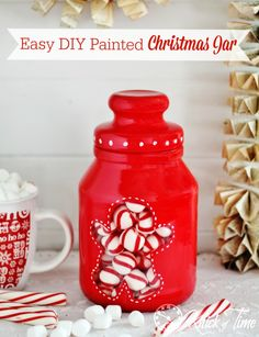 This easy DIY painted jar looks so festive, and tempts your family and friends with the sweet treats you can see inside it!
