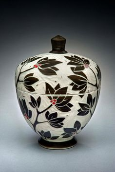"Karen Newgard, ""I have chosen to use the sgrafitto carving technique on porcelain because it gives me a graphic quality and clarity of image. I finish the wheel thrown pots in a salt kiln that does the glazing for me and preserves the carved areas. I am influenced by many pottery traditions as well as my peers in Western North Carolina."""