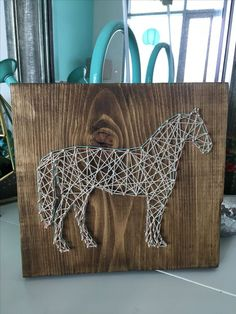 Horse string art with walnut stain and brass nails created by Turquoise Boutique Studio