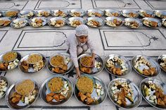 A child lines up food in preparation for the Iftar on the first day of Ramadan at the Memon Mosque in Karachi, Pakistan. - Don't forget to make dua' right before you eat at Maghrib. Ask for anything, because the moment before fast is broken, the dua's made are the ones Allah swt will bring, insya'Allah.