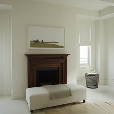 I love the white, start room with a rich, wood fireplace surround.  Park Avenue Duplex - desire to inspire - desiretoinspire.net