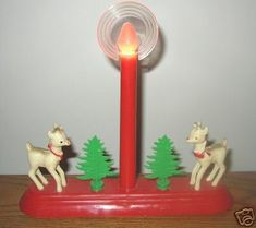 Vintage early 1950's Candle Electric Light with 2 Reindeer & 2 Trees Another treasure from my in-laws attic. At least 60 years old. Red base with center 7  candle has working red bulb with 2 3/4  halo