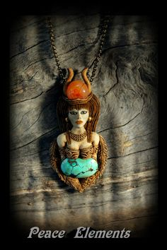 Egyptian Goddess Isis Queen of heaven Sculpted clay pendant