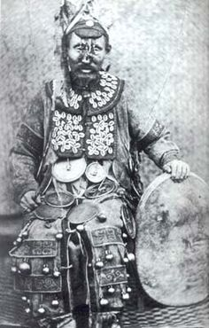 Shaman: A Shaman from Siberia, photographed with his drum in 1882.