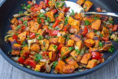 This quick and easy Vegetarian Sweet Potato Hash recipe with onions, garlic, peppers and smoked paprika is a delicious side, main, breakfast item or filling. #sweetpotatohash