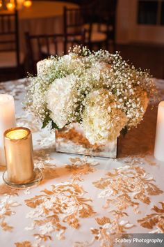 Traditional Winter Wedding | Short centerpiece with baby's breath and hydrangeas featuring a luxurious, patterned linen. | www.CocoRedEvents.com | Photo cred: www.scobeyphotography.com