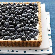 Blueberry and Buttermilk Tart - The crisp, buttery shortbread base gets a surprise crunch from ground almonds. The tangy buttermilk custard that fills the shell is the perfect complement to the abundance of sweet, plump blueberries scattered over the top.