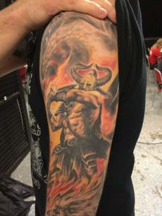 "What an amazing tattoo! Inspired on the album ""Surtur Rising"" by the swedish Death Metal band Amon Amarth. I loved it."
