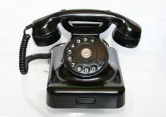 Old cord phones vintage telephone cordless phones with call blocking cordle British Country Style, Phone Logo, Vintage Telephone, Dinner Recipes For Kids, Vintage Walls, Phone Holder, Landline Phone, 1940s, Antiques