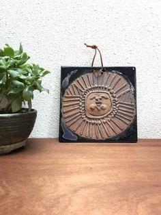 Vintage sun face tile / studio pottery wall hanging
