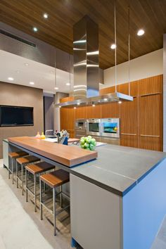great way to have normal counte with higher eating place    Modern kitchen design in grey, white and natural wood color scheme capped with dark ceiling