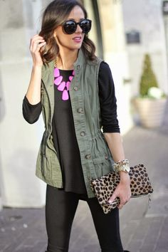 utility vest + all black + statement necklace + leopard clutch