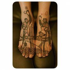 Matching illustrative tattoo.