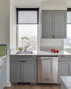 Gray cupboards with copper hardware | Lonny.com