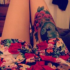 Lovely thigh piece tattoo