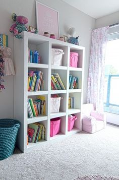 Luv Ikea bookcase in girls room.