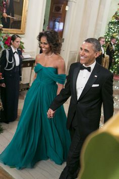 """This """"Fancy Friday"""" is our very own First Lady. Michelle Obama stunned in a floor-length custom Marchesa gown at the 2013 Kennedy Center Honors last month. With President Obama by her… Michelle Und Barack Obama, Barack Obama Family, Michelle Obama Fashion, Obama President, Vestidos Marchesa, Marchesa Gowns, Marchesa Fashion, Best Gowns, Black Presidents"""