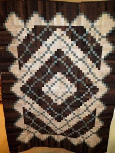 Peaceful Valley Log Cabin quilt made by Lois Vincent. The pattern is from Judy Martin's book, Extraordinary Log Cabin Quilts. Viewer Photos