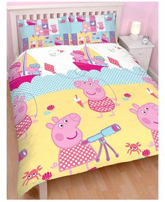 This adorable Peppa Pig Nautical duvet cover set is the perfect finishing touch for a Peppa themed room. The front of the duvet cover features Peppa and George sailing on a blue and white polka dot sea, with Peppa playing on the sand in the foreground. The reverse features a collage of patchwork style seaside themed images.