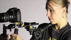 Recoil XT by ikan. This comfortable, ergonomic camera rig is your best bet for hand held DSLR shooting, with a standard 15mm rod system and an adjustable chest brace. Check out http://www.ikancorp.com/productInfo.php?id=289 for more details.