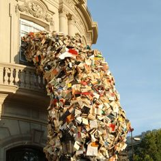 Books pour out of a building
