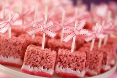 Rice krispy treats dipped in white   chocolate and sprinkles, all on a stick.  Cute idea for a baby shower or make   them red and serve to your Valentine on Valentine's Day!