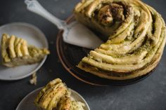 Learn how to easily make a cheesy herbed swirl bread filled with a quick homemade pesto by following this recipe!