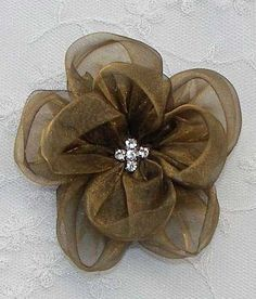 Rhinestone Antique Gold Organza Rose Flower Pageant Corsage Bow. $3.50, via Etsy.