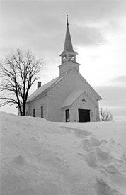 This little white church is part of a Christmas country historic church tour you can find in New Wells, Missouri.