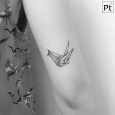 Origami crane tattoo on the back of the right arm. Tattoo artist: Pablo Torre