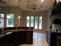Revere pewter walls, ebony cabinets and coffee brown granite Brown Granite, Revere Pewter, Corner Bathtub, Cabinets, House Ideas, Walls, Paint, Coffee, Kitchen