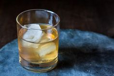 Sazerac  2 ounces rye whiskey 1/4 ounce simple syrup 3 dashes Peychaud bitters Ice 1 barspoon Herbsaint or absinthe (sub Pernod in a pinch) Lemon twist