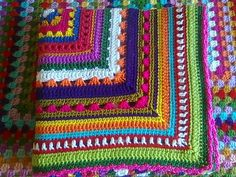 This picture gives me an idea for using up yarn leftovers. Start with a granny square then make each round a different color and different pattern.