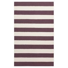Lend classic appeal to your living room or master suite with this hand-woven rug, showcasing a thick stripes motif in raisin.  Produ...
