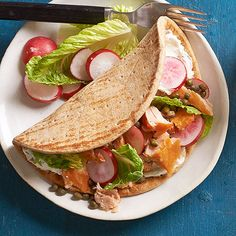 Eat colorfully! A smear of store-bought onion-chive cream cheese creates a lush base for golden salmon, blushing radishes, and freshly torn lettuce. Purchased flatbreads help cut down on prep time.