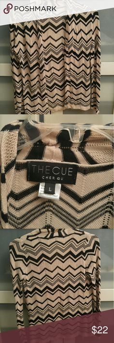 NWOT The Cue Cher Qu Zig Zag Wrap size L New without tags gorgeous zig zag beige and black wrap in size L.?  Gorgeous, just sitting?in the closet for 2 years and in completely perfect condition.?  Material is 10% cotton and 90% acrylic. The feel of the wrap is very light and breezy but adds that touch of another layer on top. Point being, it is comfy and fashionable!   Pics above, any questions please ask!  Happy shopping:] Sweaters Cardigans