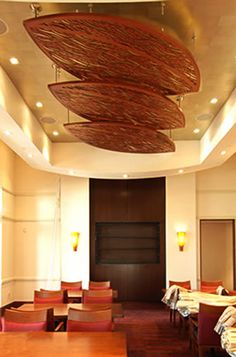Custom leaf shaped Waterfall Ceiling panels for the Moorings Park Trio Restaurant in Naples, FL
