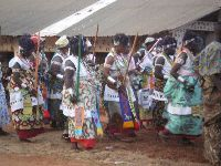 Abomey, Benin, Women's Society (Amazons) ceremony. The Amazon corps was established by Queen Hangbe (1708-1711). They provide security and assault in the final wars. King Guezo (1818-1858) reorganized this army. The court at the time of Guezo was greater than today, with 200 Amazons. They represented 30% of the army. They were recruited between 12 and 14 years old, in villages and urban centers and among the captives of war and selected according to their physical stoutness.