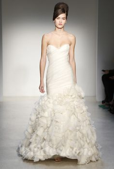 Brides.com: Kenneth Pool - Fall 2013. Strapless mermaid wedding dress with a sweetheart neckline, draped bodice, and ruffled skirt, Kenneth Pool  See more Kenneth Pool wedding dresses in our gallery.