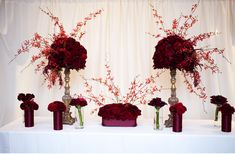 dramatic red wedding flower centerpieces topiaries Credit Genevieve Leiper