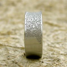 His wedding band with her fingerprint. Coolest thing ever...so sweet!