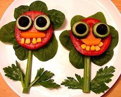 Tomato, spinach, cucumber, black olives, carrots, corn and celery stalk. YUM!  (ok the corn teeth look kinda creepy... but I am sure the kids will think they are cute and goofy :)