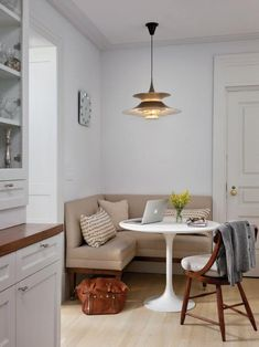 White Transitional Kitchen with Banquette Seating