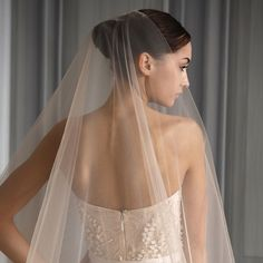 Monique Lhuillier #Bridal: A #veil in the lightest coral accentuates beautiful skin and warms up the look