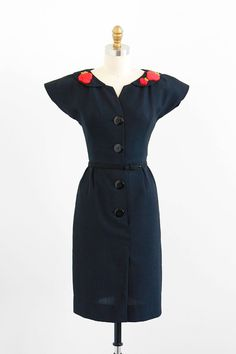 vintage 1950s little black dress with red strawberry appliques.