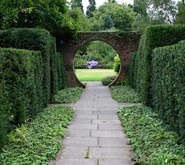 A seventeenth century house with a twentieth century woodland garden, made since 1957 by Roderick Cameron. There are grass walks, borders, statuary, a heather g Hd Landscape, Landscape Design, Garden Design, Garden Steps, Garden Paths, Heather Gardens, Pictures Of England, Moon Gate, Gardens Of The World
